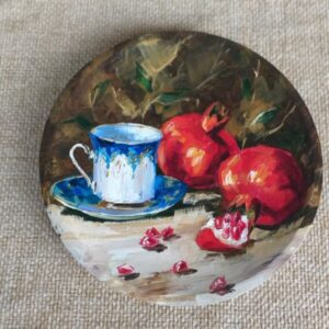 Pomegranates with cup
